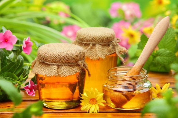 bigstock-Honey-in-glass-jars-with-flowe-44092480