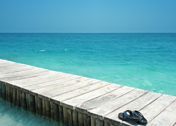 bigstock-Sandals-On-Oceandock-2293515