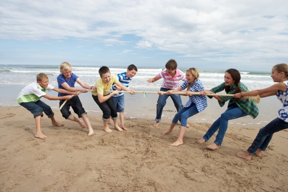bigstock-Teenagers-playing-tug-of-war-27385718