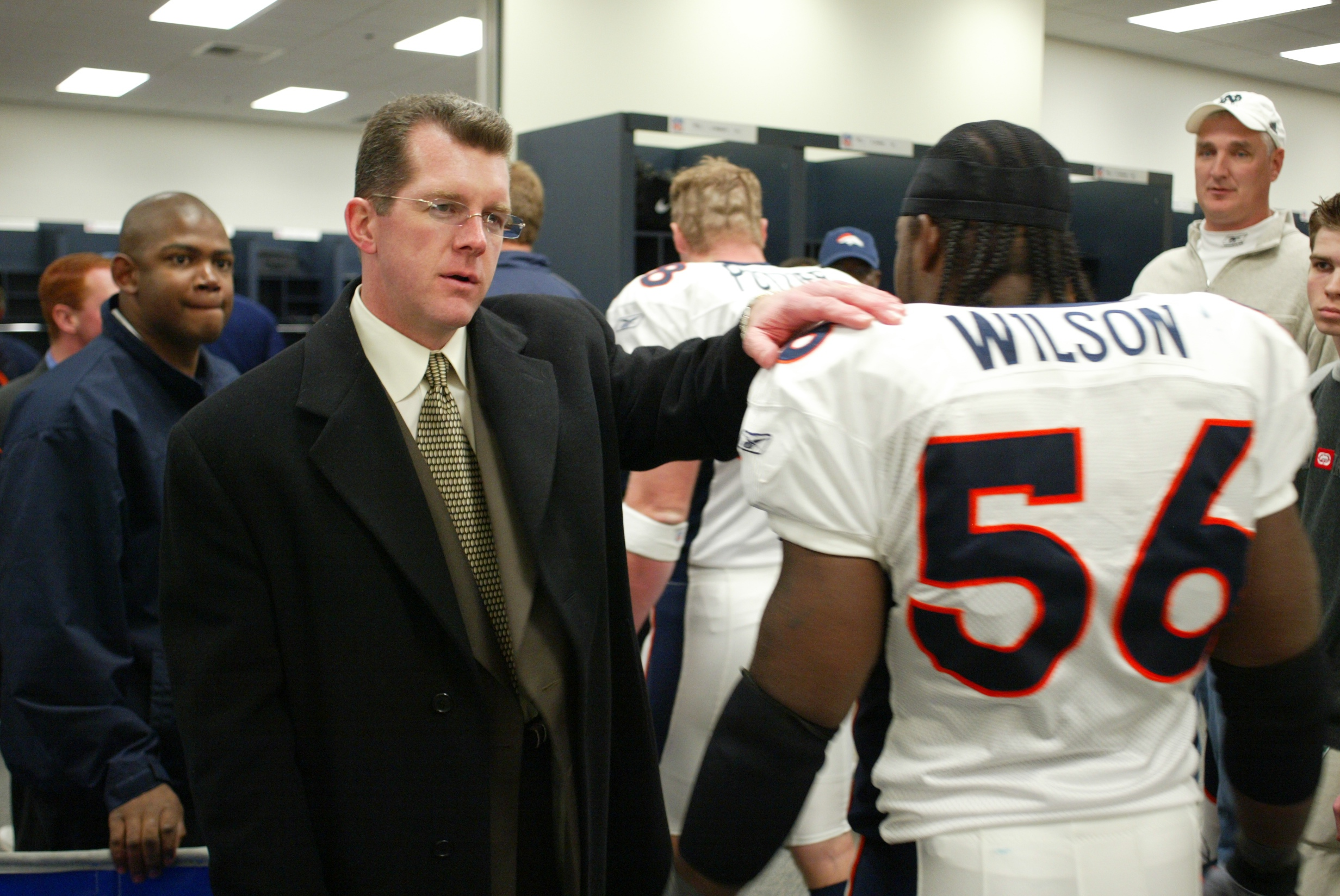 Greeting linebacker and team captain Al Wilson after a hard fought win on the road.