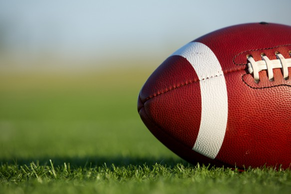 bigstock-American-Football-on-the-Field-36441772