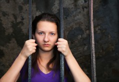 Young Woman Behind The Bars