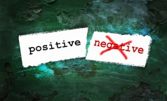 Positive And Negative Written On Piece Of Paper