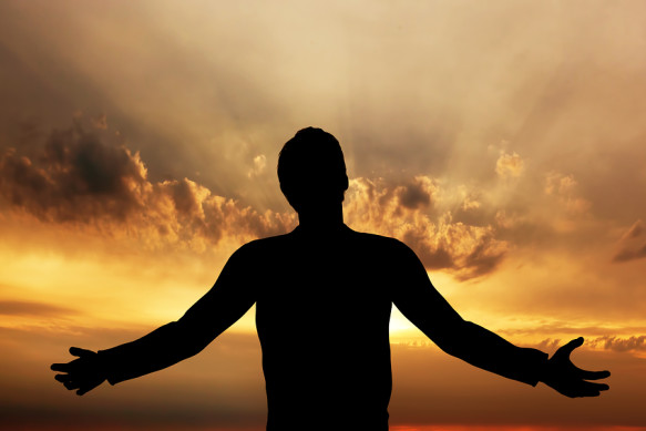 Man praying, meditating in harmony and peace at sunset. Religion, spirituality, prayer, peace.