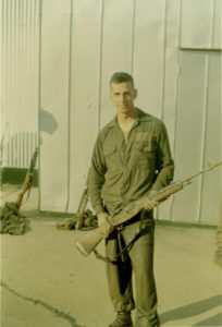 Ken Marlin holding a rifle at OCS Quantico VA @ 1972