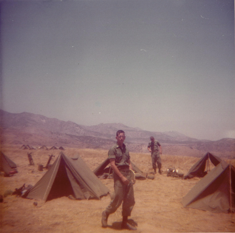 Ken Marlin walking near tents at Marine Corps Base 29 Palms CA @ 1973