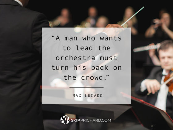 """A man who wants to lead the orchestra must turn his back on the crowd."""